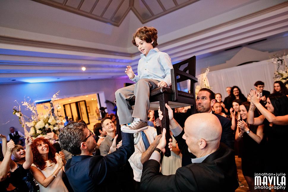 08-Mavila-Photography-Bat-Mitzvah-Lehman-Horah-Chair.jpg